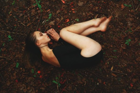 laying-on-ground-woman-earth-sad-depressed-love-alone